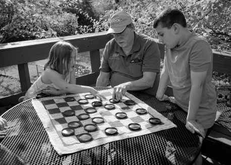 Pop picked up a checkers set at a yardsale. They played for hours...